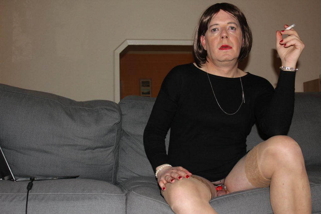 Ladyboy in chastity.
