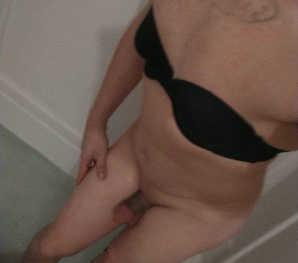 Sissy bitch in a bra shows her tiny clit