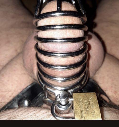 Mistress keeps him caged like a cuck